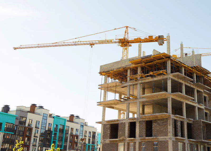 crane and building at construction site