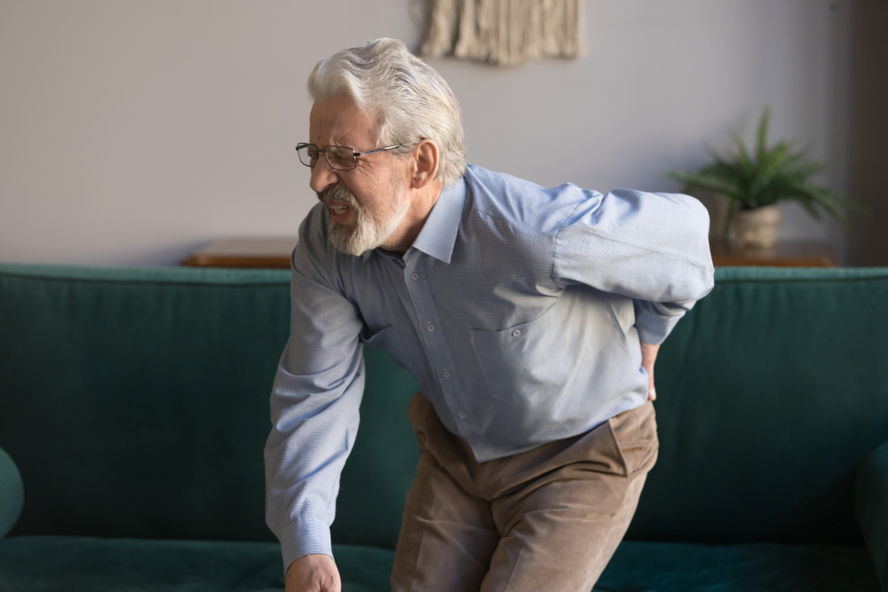 old man having back pain problem