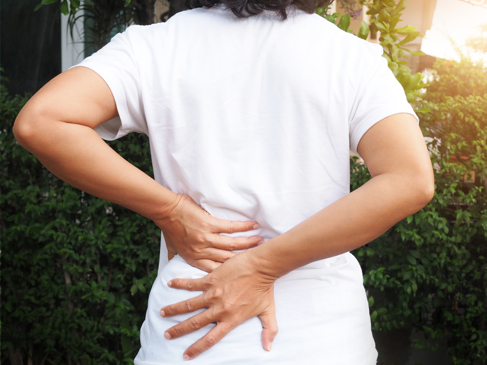 woman having lower back pain